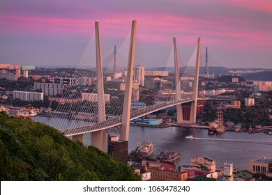 Zolotoy Bridge is cable-stayed bridge across the Zolotoy Rog (Golden Horn) in Vladivostok, Russia.  Zolotoy Bridge in sunset