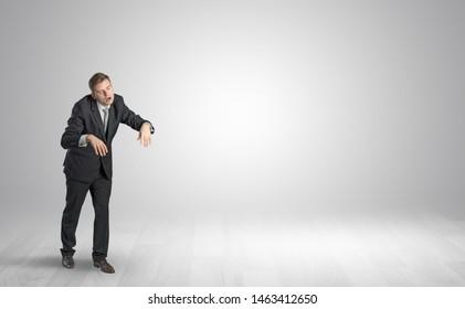 Zombi, sleepy maniac businessman walking in a copy space