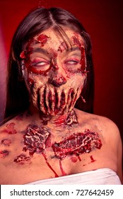 Zombie girl with sad eyes on a red black background, image on Ha