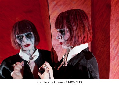 zombie girl with short red hair and her reflection in mirror