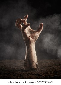 Zombie hand climbs out of the ground