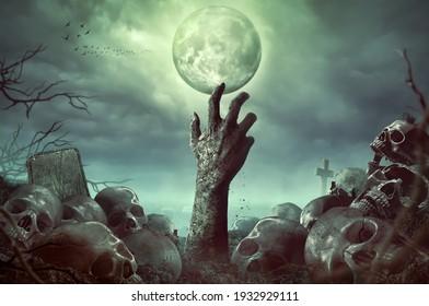 Zombie hand rising in dark Halloween night.