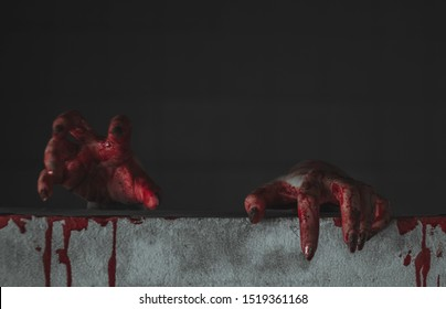 Zombie hand through wall. Zombie hand climb wall. Halloween concept. Horror and Scary concept.