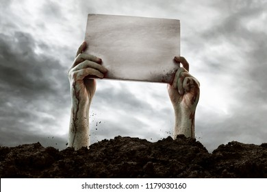 Zombie hands holding blank sign