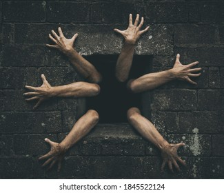 Zombie hands rising out from old damaged window. Darkness horror and halloween background concept.