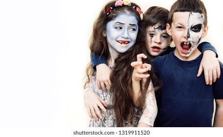 zombie kids concept. Birthday party celebration facepaint on children dead bride, scar face, skeleton together having fun