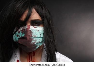 Zombie nurse with bloody white shirt