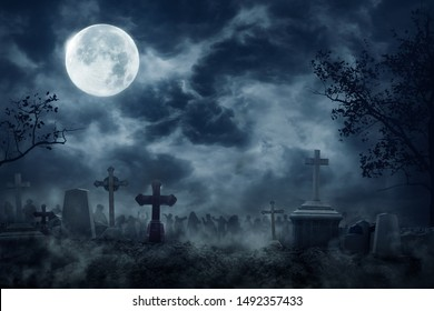 Zombie Rising Out Of A Graveyard cemetery In Spooky dark Night full moon. Holiday event halloween background concept.
