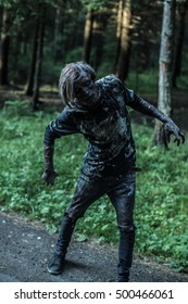 Zombie is walking through the woods.