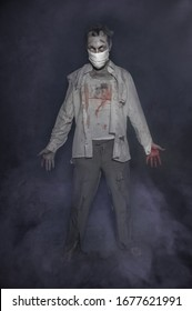 Zombie wearing medical face mask. Coronavirus, pandemic and Apocalypse concept