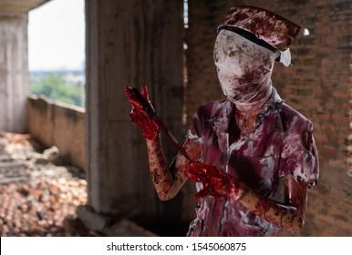 Zombie woman,horror shot the scary evil insane nurse doctor,beautiful, sexy woman,psychosis woman,halloween theme