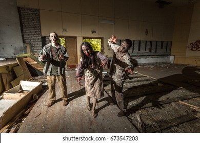 Zombies attack in an abandoned dark building