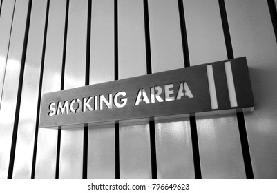 Zone for smoking area sign on wall outside building in black and white tone