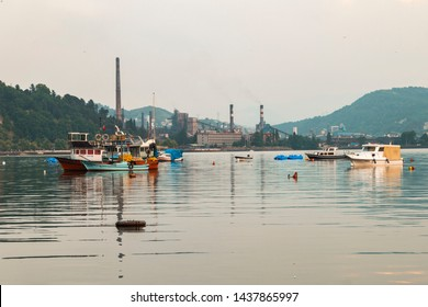 Zonguldak eregli district, fishing boats and erdemir iron and steel factory behind June 24,2019, Eregli, Zonguldak, Turkey