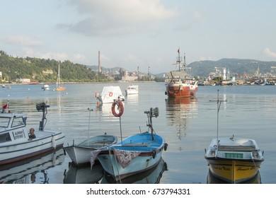 Zonguldak eregli district, fishing boats and erdemir iron and steel factory behind June 24,2017, Eregli, Zonguldak, Turkey