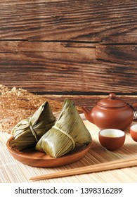Zongzi also called  rice dumplings or sticky rice dumplings on wooden background. Dragon boat festival is a traditional festival of East Asian culture. Food concept. Southern Taiwan taste. Copy space.