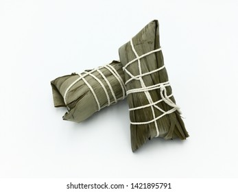Zongzi or rice dumplings are traditional Chinese food. Rice dumplings made by wrapping sticky rice pork red beams peanut yolk mushroom in bamboo leaves. Cantonese rice dumplings are long and slim.