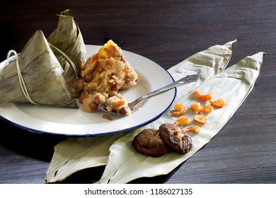 Zongzi or sticky rice dumpling on white dish, (chinese food) / Select focus