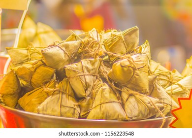 Zongzi sticky rice dumplings for sale at he street night market. Zongzi is a traditional Chinese rice dish made of glutinous rice stuffed with different fillings and wrapped in bamboo leaves.