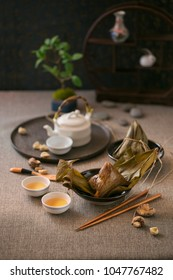 Zongzi is a traditional Chinese food made of glutinous rice stuffed with different fillings and wrapped in bamboo reed, or other large flat leaves. They are cooked by steaming or boiling.