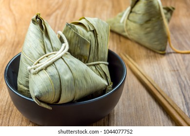 Zongzi or Traditional Chinese Sticky Rice Dumplings in a Black Bowl