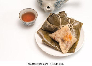 Zongzi - Traditional Dragon Boat Festival dumpling isolated on white background.