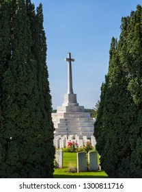 Zonnebeke, Belgium - August 10th 2012: The Cross of Sacrifice in Tyne Cot Cemetery in Belgium. Tyne Cot is a cemetery for Commonwealth soldiers who died in the Ypres Salient during the 1st World War.