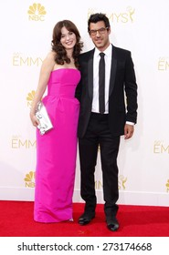 Zooey Deschanel and Jacob Pechenik at the 66th Annual Primetime Emmy Awards held at the Nokia Theatre L.A. Live in Los Angeles on August 25, 2014 in Los Angeles, California.