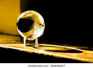 A zoom ball with gold colors and design. Abstract background image. Glas Ball in Yellow and Black with shadows and light reflection. - Shutterstock ID 2036496617
