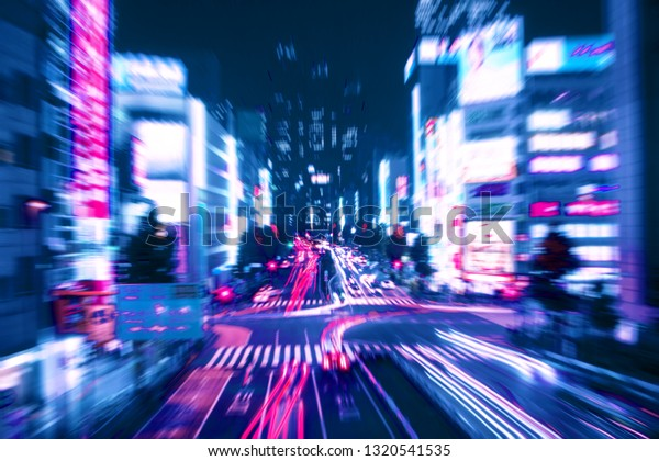 Zoom Effect of Night Time Traffic in Shinjuku District, Tokyo, Japan with a Retro Synthwave Color Effect