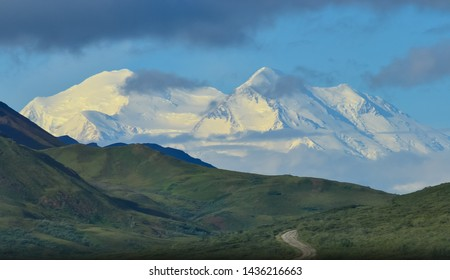 Zoom photo of Mount Denali (mt Mckinley) with Denali park road Denali National Park and Preserve, Alaska, United States