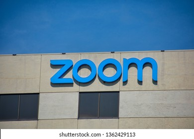 Zoom sign and logo is displayed on startup headquarters in Silicon Valley. Zoom Video Communications IPO filed to go to the public on Nasdaq market - San Jose, California, USA - April 7, 2019