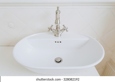 Zoom of sink with old style basin tap
