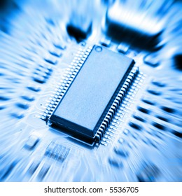 zoomed blu background with motherboard's electronic circuit