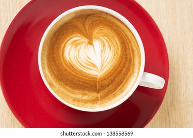 Zoomed cup of coffee with foam heart illustration