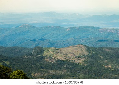 Zoomed horizontal landscape view of Pitawala Pathana trek/trail, Riverston, Matale, Sri Lanka. Surrounded by series of other mountain layers in the background extending to the horizon