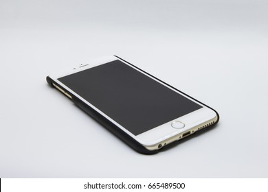 Zooming closeup view of iPhone 6 plus in black simple decorative case surrounded by isolated white background. Photo taken in June 22  2017.