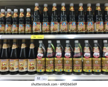 Zooming closeup view of numerous transparent bottles of dark soy sauce in a few famous Thai brand s arranging on a shelf for purchase in a supermarket in Thailand. June 20 2017