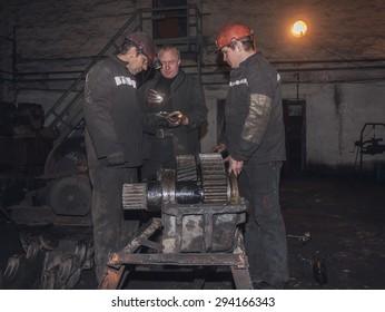 Zorinsk, Ukraine - March 18, 2013: Locksmiths repair of mining equipment. Mine Nicanor