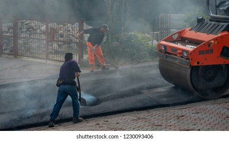 zorzone Italy November 14th 2018:workers at work to redo the road surface