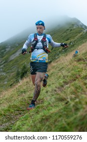 Zorzone Serina italy 2 September 2018: Extreme mountain race competition skymarathon. athlete during technical race on the wet meadow downhill