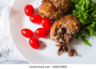 Zrazy - meat roulade dish popular in Eastern Europe, especially in Poland and Lithuania. Zrazy serving with cherry tomatoes and arugula.