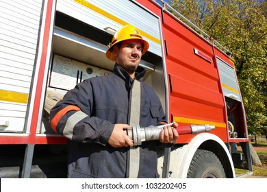 Zrenjanin ; Serbia ; 10/19/2017 ; Fireman stands in front of a fire truck