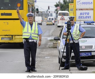 ZRENJANIN, SERBIA - CIRCA AUGUST 2014: Policeman controls drivers at local road, circa August 2014 in Zrenjanin