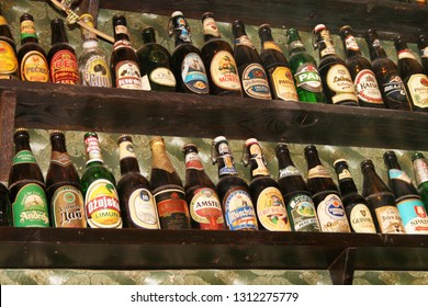 Zrenjanin, Serbia – January 22nd, 2019: The beer bottles collection at the wall in a popular pub
