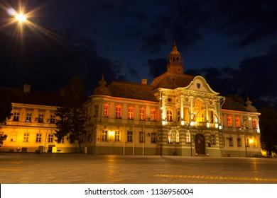 ZRENJANIN, SERBIA - JUNE 3, 2018: Town square at night. Municipality building city of Zrenjanin