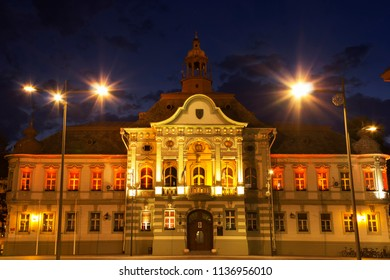 ZRENJANIN, SERBIA - JUNE 3, 2018: Town square at night. Municipality building, front view.