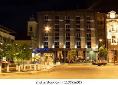 ZRENJANIN, SERBIA - JUNE 3, 2018: Town square at night, look at Hotel Vojvodina