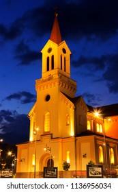 ZRENJANIN, SERBIA - JUNE 3, 2018: Town square at night, Catholic church in Zrenjanin, Serbia