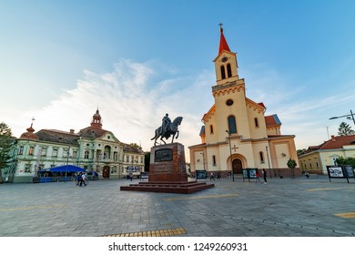 Zrenjanin, Serbia - May 17, 2018: Zrenjanin downtown, city architecture, urban landscape. Square of freedom with Cathedral of St. John of Nepomuk,city hall and a monument of King Petar Karadjordjevic